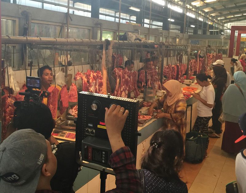 Filming on location in wet market for fresh meat and produce, Pasar Modern BSD City, Banten, Indonesia